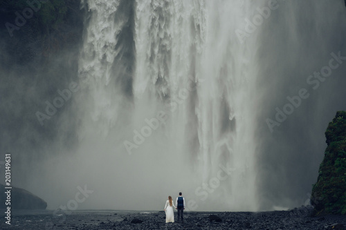 Foto op Aluminium Donkergrijs Happy stylish smiling couple walking and kissing in Iceland , on