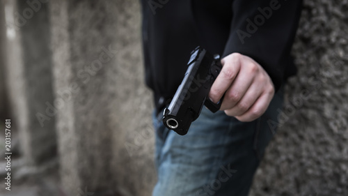 Fotomural  Terrorist's hand with a pistol