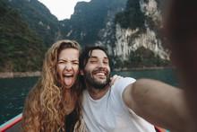 Couple Taking Selfie On A Long...