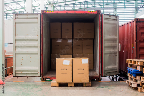 The cartons with loading out of container Fototapeta