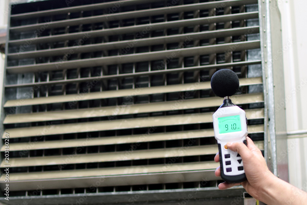 Fototapeta Sound level meter measuring the noise of industrial ventilation unit.