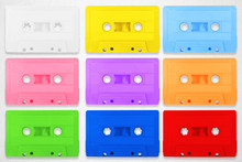 Collection Of Retro Cassette Colorful Tapes Places On White Background.