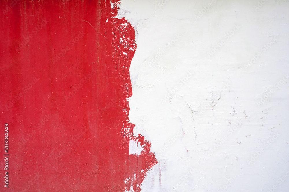 Fototapety, obrazy: The texture of the wall is half white, half red.