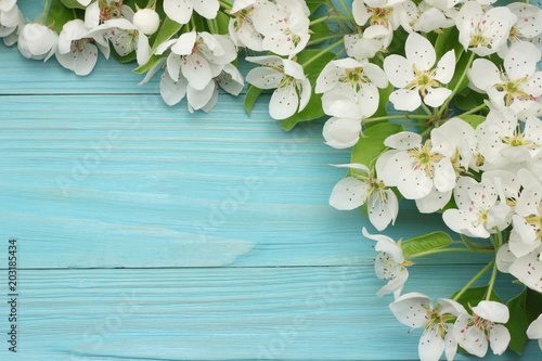 Staande foto Lelietje van dalen Spring background with white flowers blossoms on blue wooden background. top view