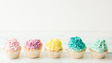 Five Colorful Cupcakes On A Light Background. Copy Space