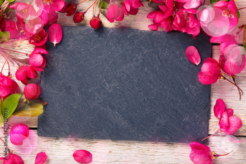 Fototapeta Spring background with slate board and flowers
