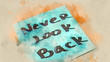 Motivating quotes. Popular slogan Never look back. Watercolor background