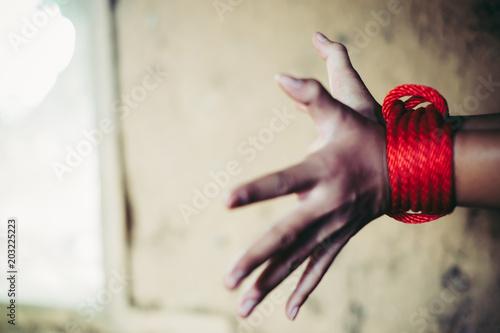Fényképezés  closeup children hand with red rope