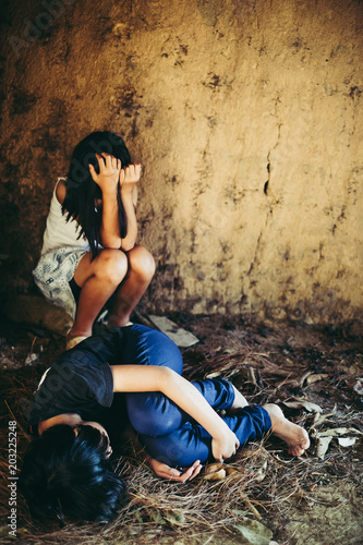 Vászonkép  Two girl on dirty ground with fear , Sexual violence , sexual abuse, human traff