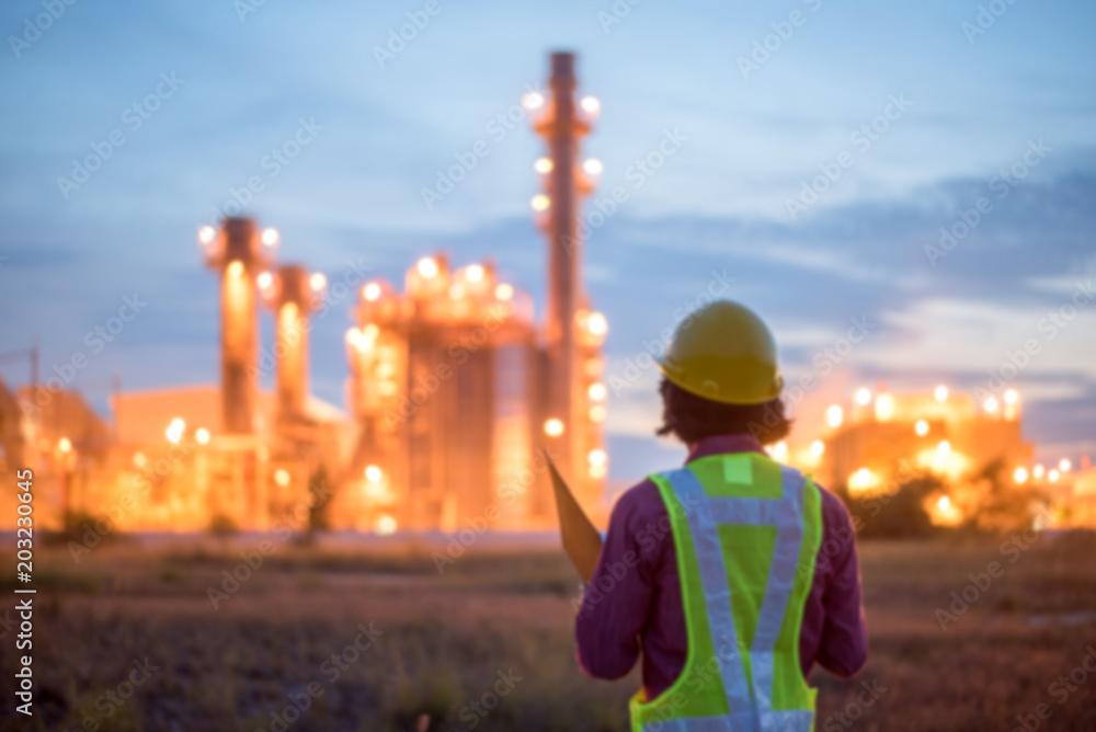 Fototapeta Engineers working in power stations./ Blur focus