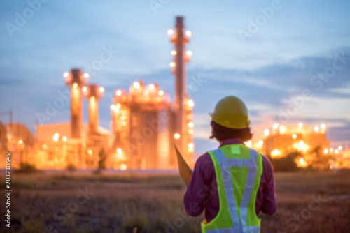 Fotografiet  Engineers working in power stations./ Blur focus