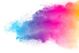 Fototapeta Rainbow - Multi color powder explosion isolated on white background. Color dust splash cloud on white background. Launched colorful particles on background.