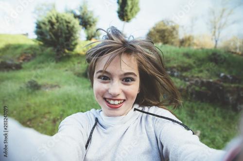 Fotografía  Close-up of young beautiful woman taking selfie