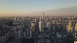 Sunset in megapolis. Video. Beautiful cityscape with top view on skyscrapers. Top view of the modern city at sunset