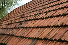 Old Tiled Roof On A Stone Hous...