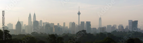 panorama view of beautiful kuala lumpur cityscape skyline in the hazy or foggy morning enviroment and buildings in silhouette