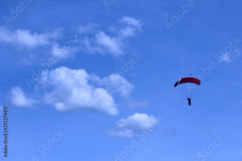Tuinposter Luchtsport Skydiver In Blue Sky. Active Hobby.Skydiving.Abstract Nature Background.