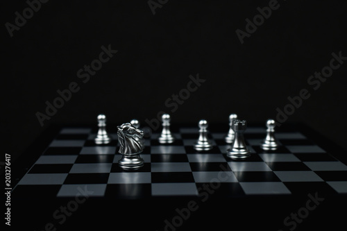 Photo  Leadership Concepts, Chess is a leader, Chess game on a black background