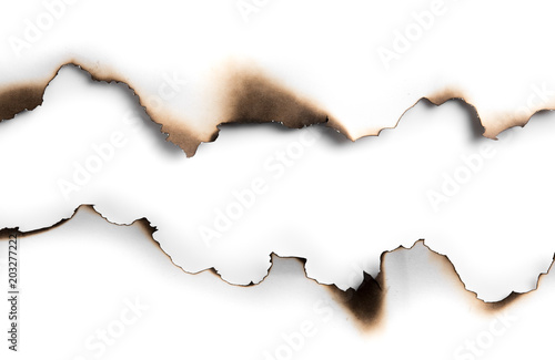 Burning paper on white paper with shadow,text copy space. Canvas Print