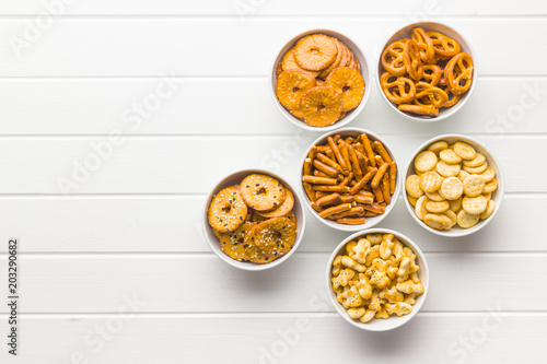 Fotografie, Tablou  Mixed salty snack crackers and pretzels.