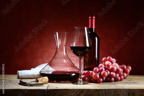 Red wine glass with bunch of grapes and decanter Canvas Print