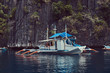 Tourist boat in a beautiful rocky bay of Philippine Islands.