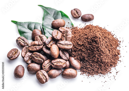 Tableau sur Toile Roasted coffee beans ground coffee on white background.