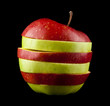 cut red and green apple on a black background