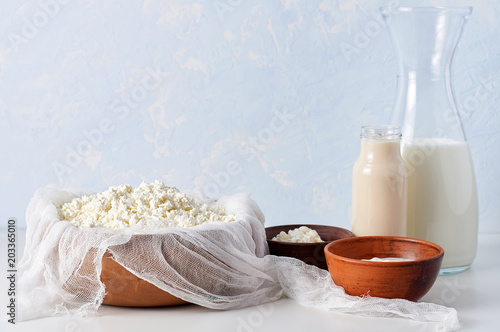 Staande foto Zuivelproducten Set of dairy products on light blue background. Cottage cheese, sour cream, mascarpone and fermented baked milk