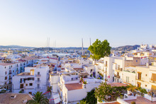 Aerial View From Medieval Fortress On Old Town, Streets And Roofs Of Houses And Port Of Ibiza Town, Balearic Islands, Spain
