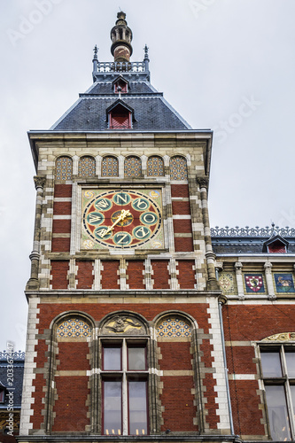 Photo  Architectural fragments of Historic building of Amsterdam central railway station (Amsterdam Centraal), Netherlands