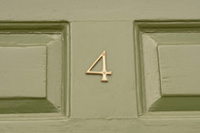 House Number 4 Sign On Green P...