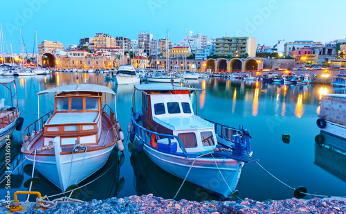 City on the water Old fishing boats in port of Heraklion