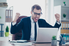 Portrait Of Excited Mad Shouting Yelling Delightful Excited Amazed Astonished Cheerful Joy Fun Joyful Banker Manager Boss Chief Employee Employer Raising Fists Up Looking At Screen With Notification