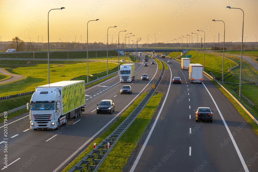 Fototapety, obrazy: evening traffic of cars on the Polish expressway