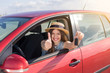 Driver woman smiling showing new car keys and car. Happy woman driver showing car keys and leaning on car door