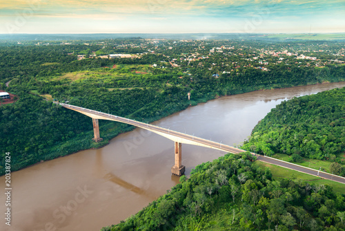 Papiers peints Amérique Centrale Aerial view of The Tancredo Neves Bridge, better known as Fraternity Bridge connecting Brazil and Argentina through the border over the Iguassu River, with the Argentinian city of Puerto Iguazu.