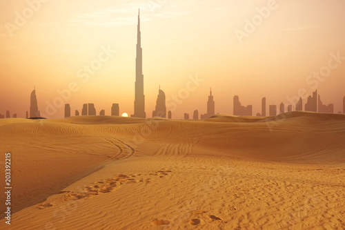 Dubai city skyline at sunset seen from the desert Wallpaper Mural