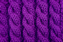 Detail Of Purple Cable Knitting Stitch