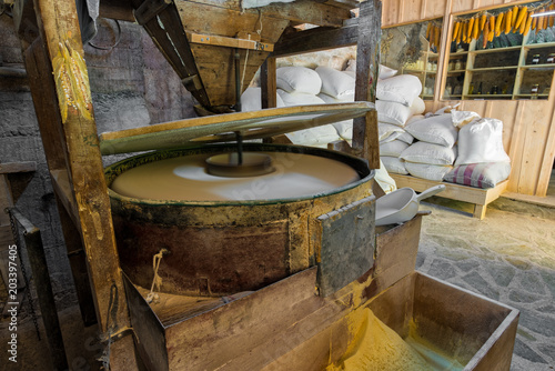 View of the interior of a traditional water mill producing corn flour in Greece
