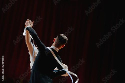 back couple ballroom dancers dancing on dark background Fototapete