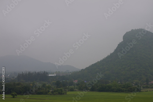 Foto op Canvas Donkergrijs Landscape of mountain and green field look from Wat Tham Suea Kanchanaburi Province Thailand.