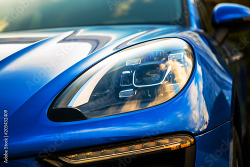 Fotografia, Obraz luxury blue car front view. sunlight