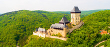 Aerial View To The Karlstejn Castle. Royal Palace Founded King Charles IV. Amazing Gothic Monument In Czech Republic, Europe.