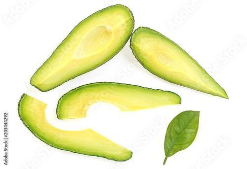Avocado slices with leaf on white background. Food concept.