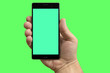 canvas print picture - Phone in hand on isolated green screen