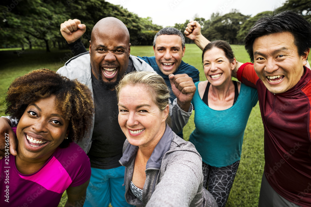 Fototapety, obrazy: Group of cheerful diverse friends in the park