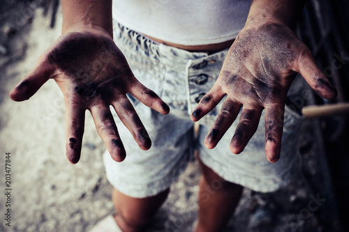 Dirty hands of children from construction work  World Day