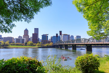 Waterfront Park With Hawthorne Bridge On The Willamette River In Downtown Portland, Oregon