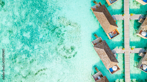 Pinturas sobre lienzo  Aerial top view water villa at Maldives island, Beautiful tropical Maldives resort hotel